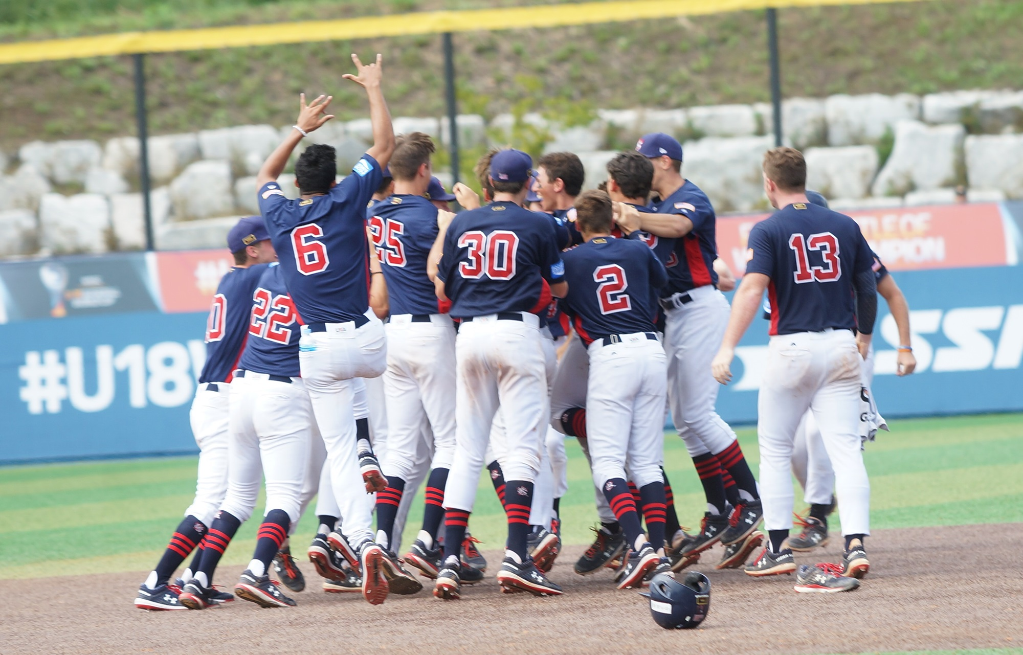 The USA players celebrate Romo after his walk-off single