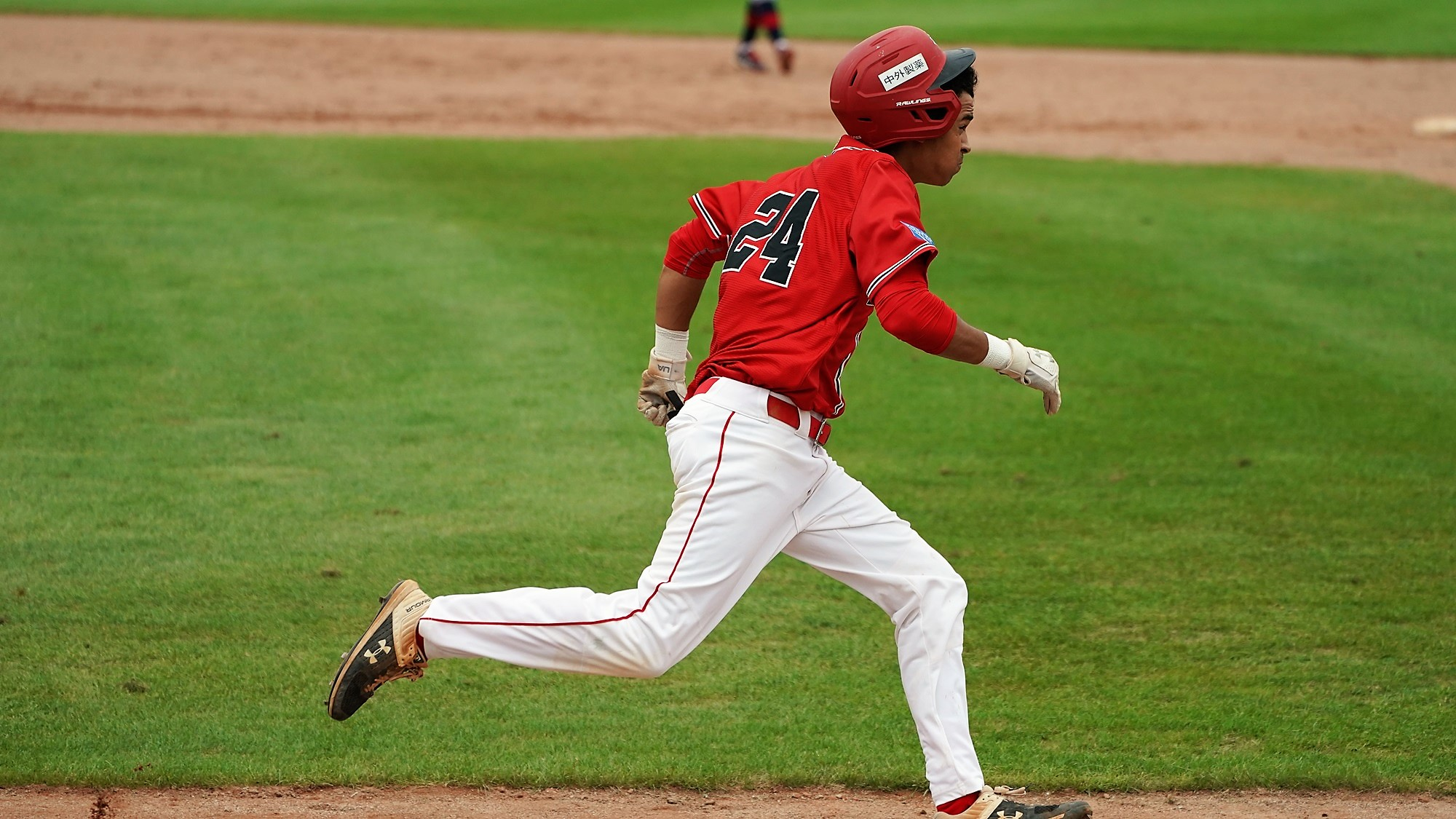 Micah Mc Dowell runs the bases, one of rare Canada's runners
