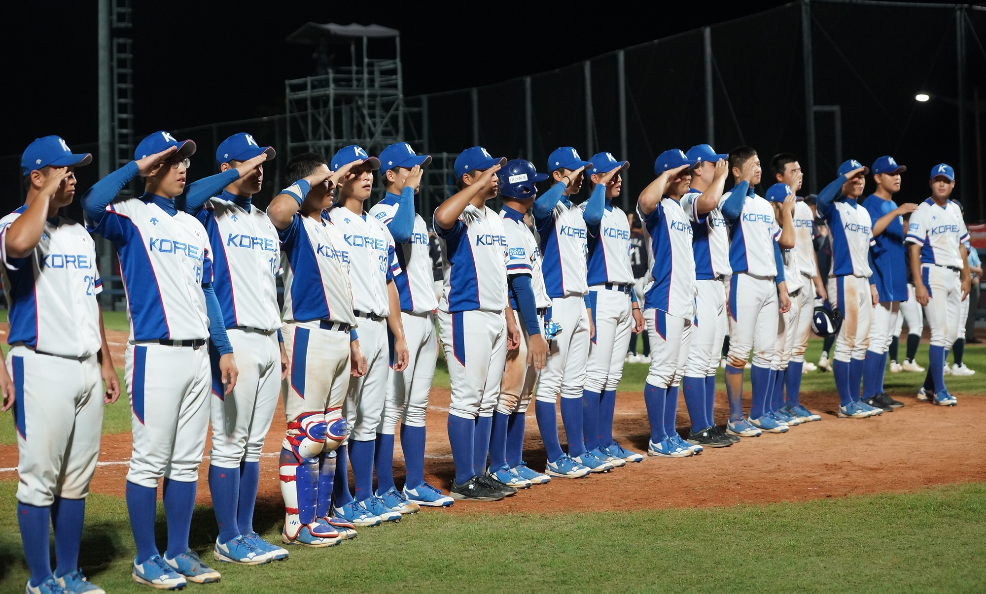 Korea's players honour the fans that were holding their breath during the winning run replay review