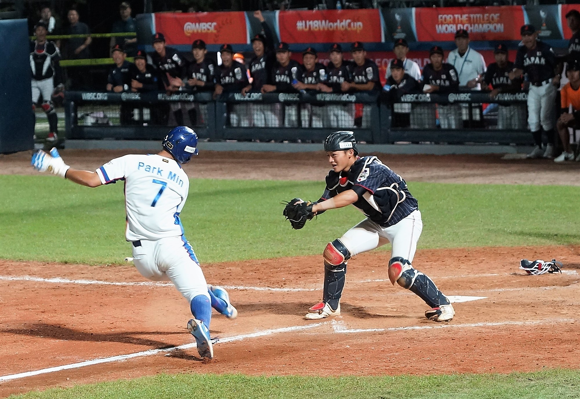 Korea lost two runners at home plate, here Park Min is nailed by a perfect throw by Hiroya Miyagi