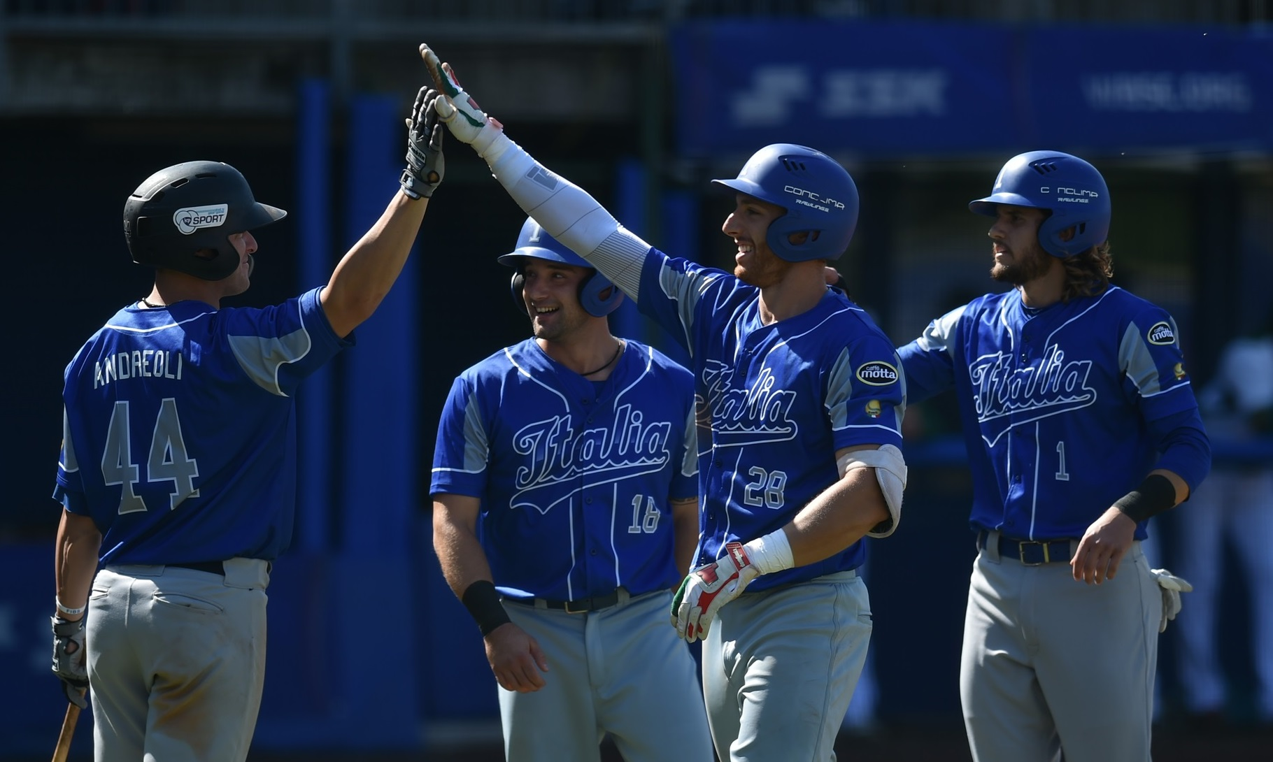 Italy celebrating after Celli's home run
