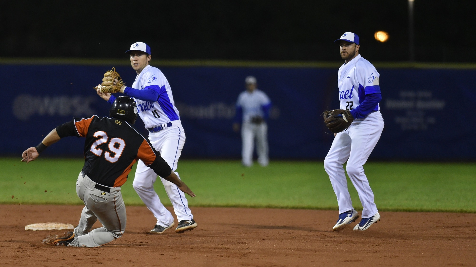 Israeli middle infield defends on Sharlon Schoop of the Netherlands