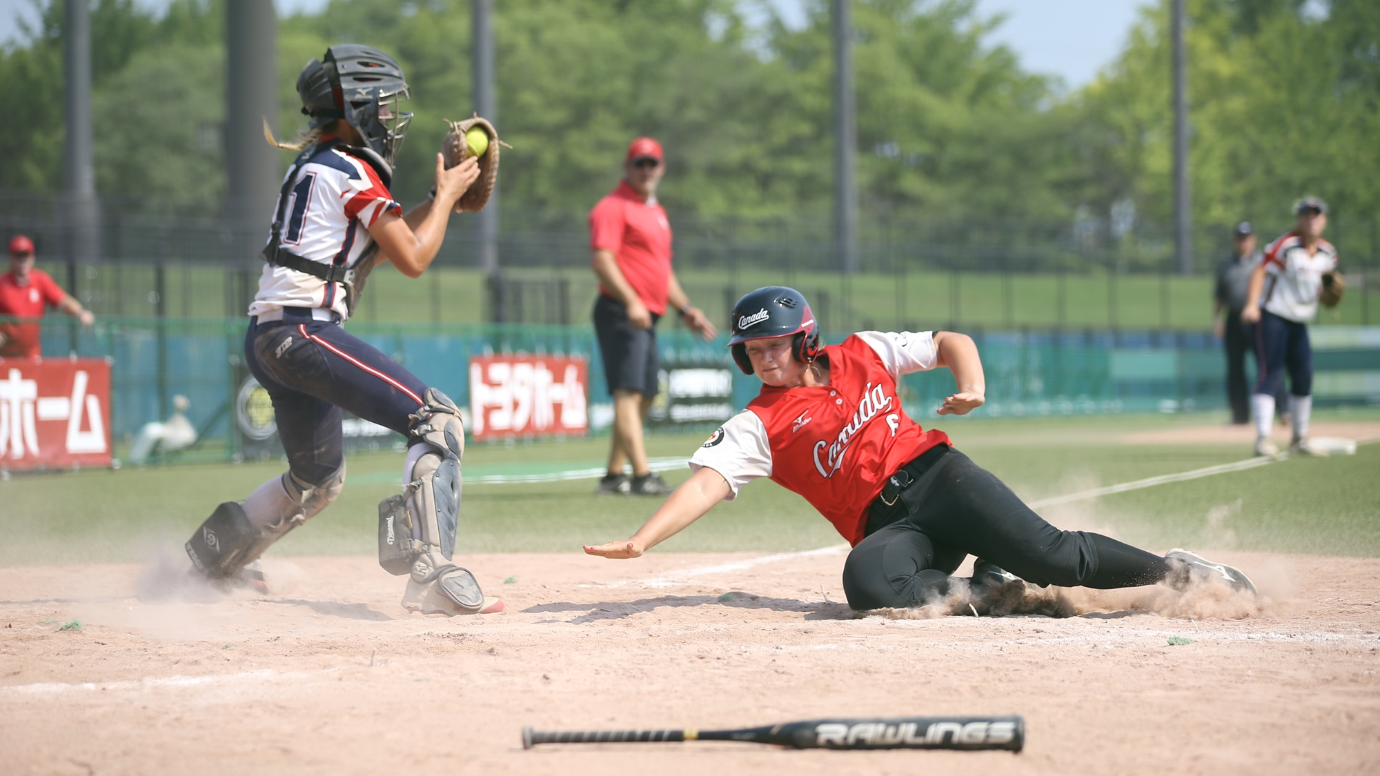 Holly Speers scores the final run of the game against Great Britain