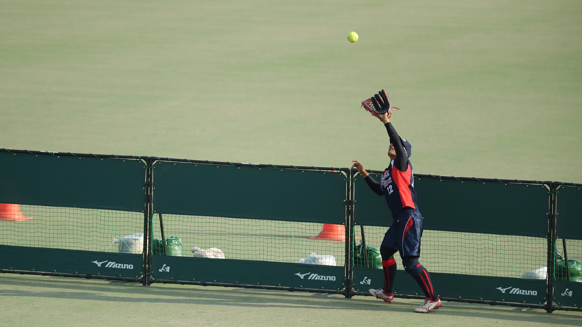 Miao-Yi Chen grabs a fly ball