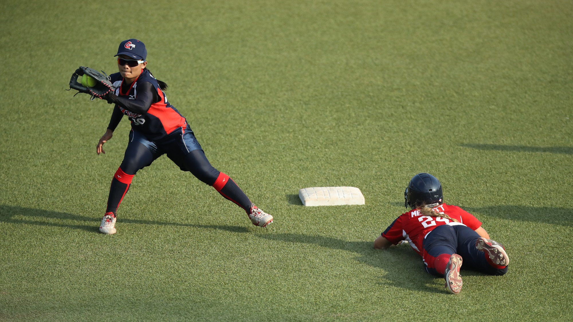 Kristi Merrit stoles second base in USA's victory over Chinese Taipei