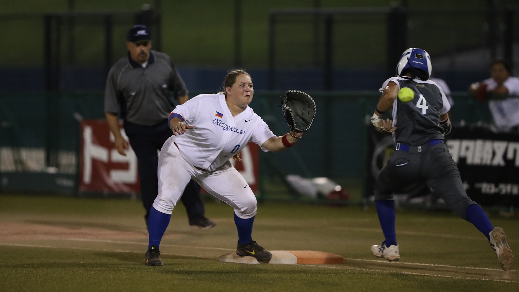 Hailey Decker puts out D'Orazio during the game between Puerto Rico and Philippines