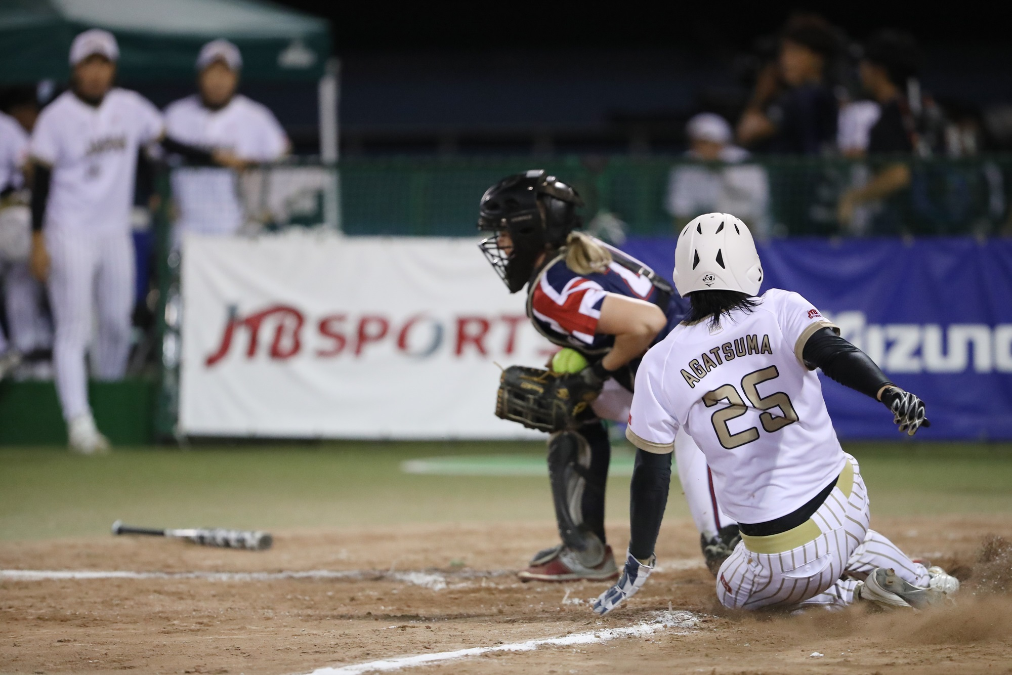 Japan's Haruka Agatsuma slides to avoid a tag from Kirsten Mack of Great Britain