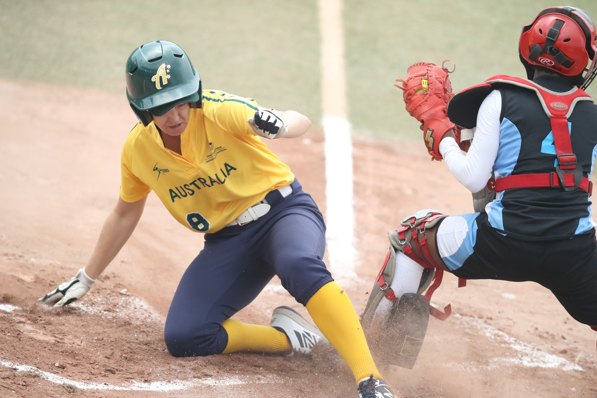 Melinda Weaver beats a throw home and scores avoiding Botswana's catcher Goitseone Monyadzwe