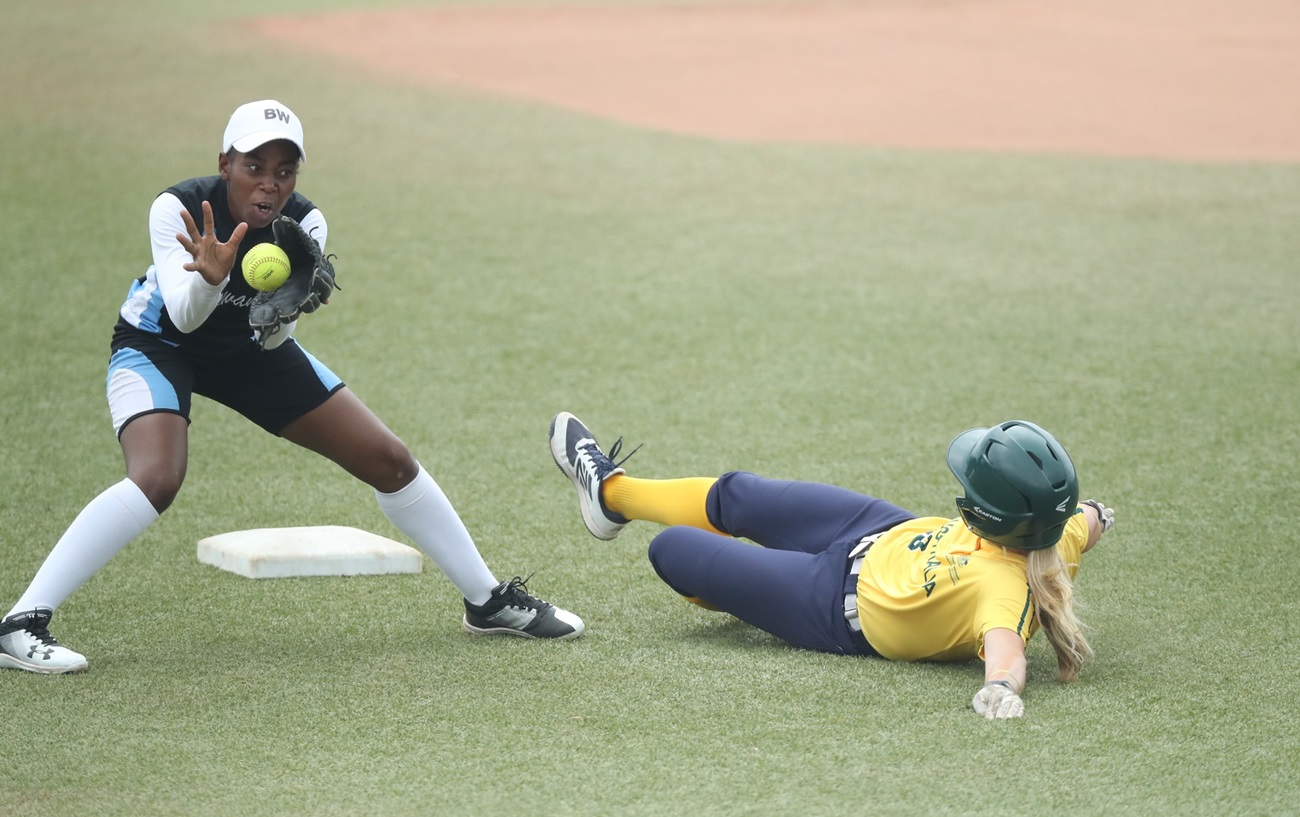Samantha Poole had 4 RBI for Australia against Botswana. Here she slides into second avoiding Neo Seth's tag