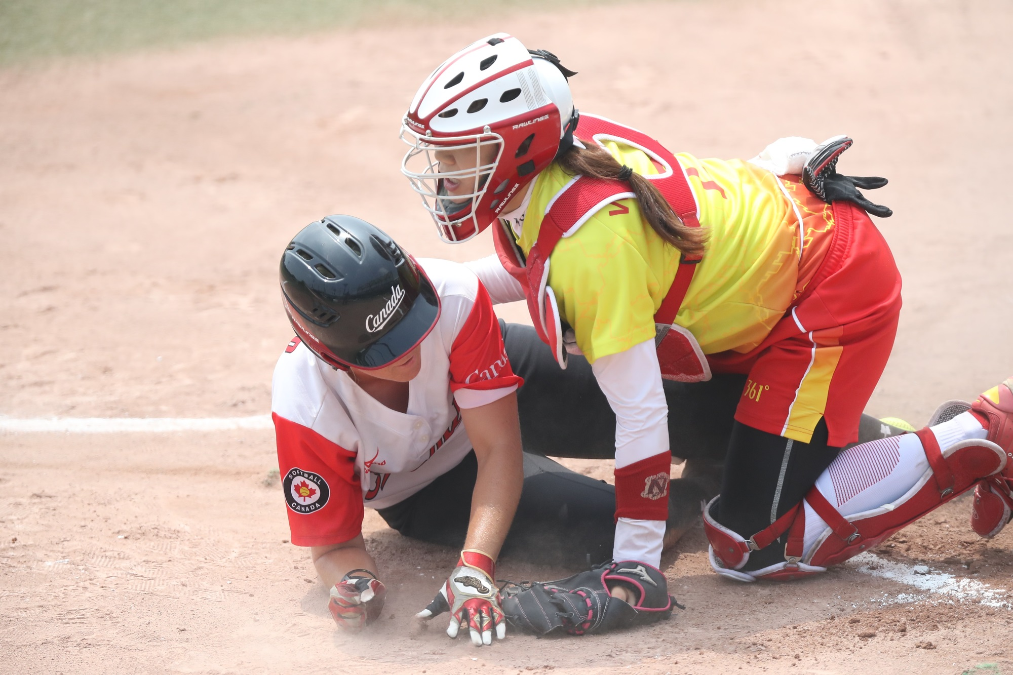 China's catcher Wang Mengyan couldn't prevent Canada from scoring