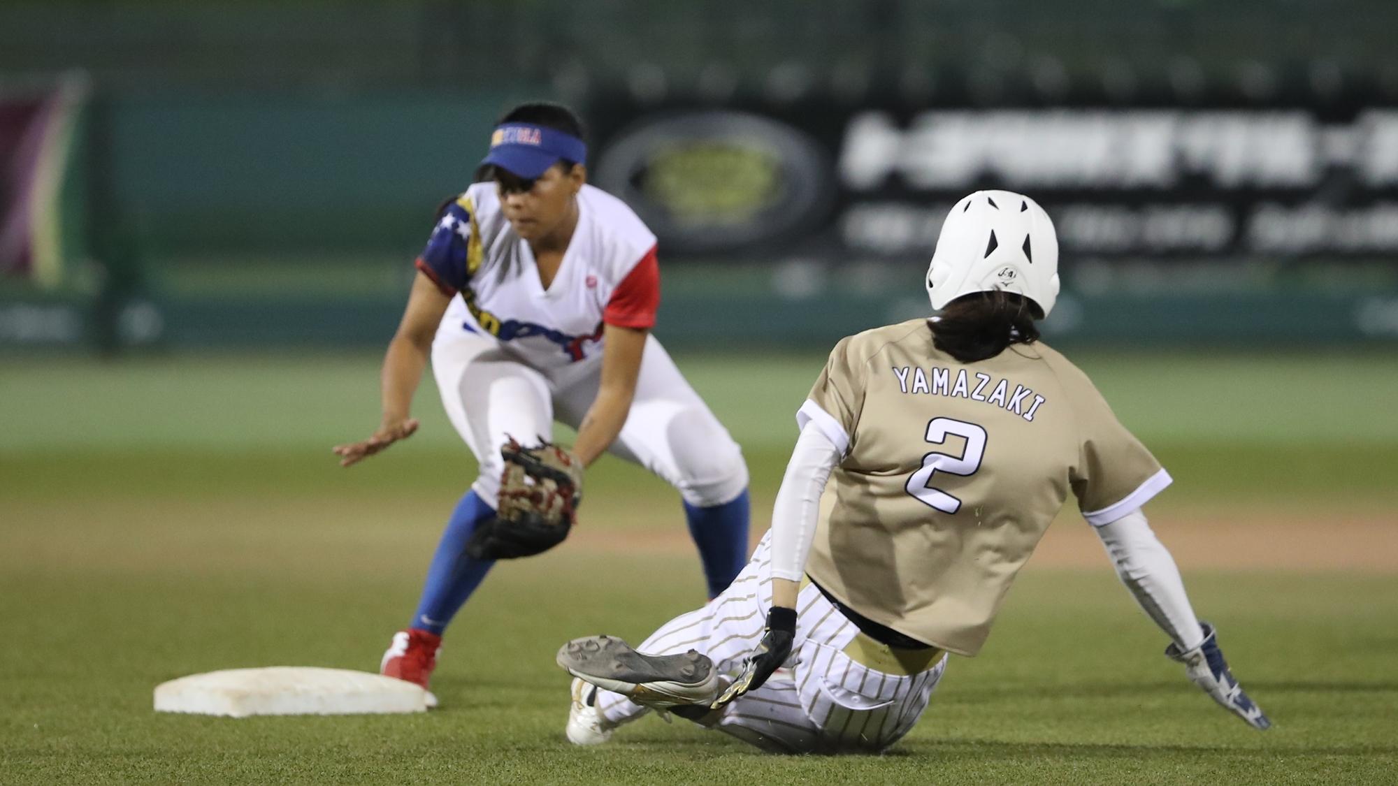Saki Yamazaki of Japan tries to avoid a tag from Estefany Duno of Venezuela