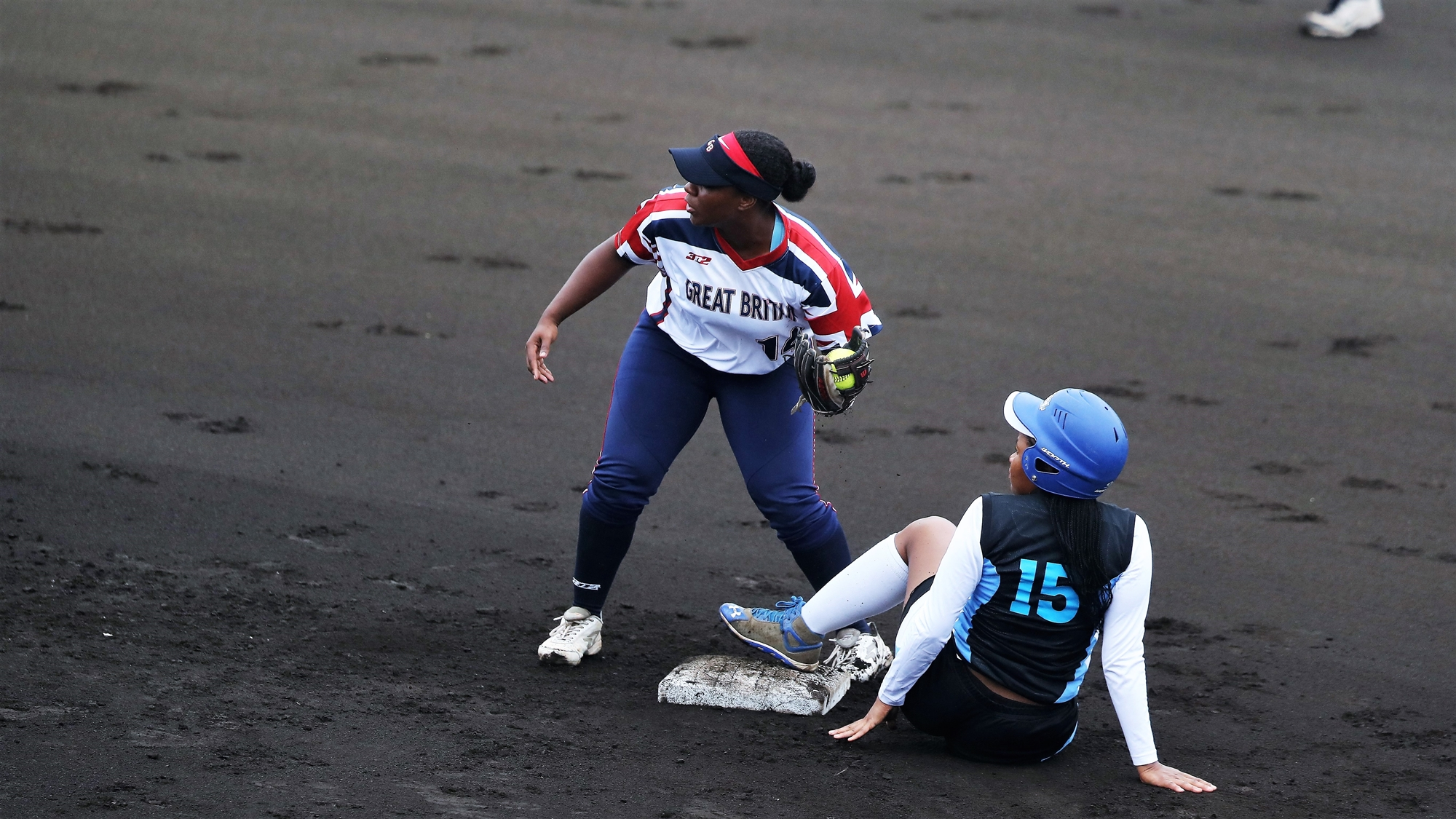 Magdeline Mabutho of Botswana tries to reach second, while Nerissa Myers of Great Britain defends