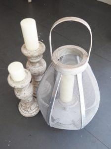 Mesh and wood bulbous lantern £49.99, outdoor candlesticks £16.99 and £18.99, from That's Nice! in Bridgnorth