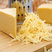 Grated Mature White Cheddar 2kg Butter Cup (Blue Tape)