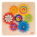 Colourful wooden cog wheel game - pieces interlocking and spinning