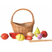 Wooden toy fruit and vegetable set in a wicker picnic basket