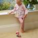 child playing with flamingo push along
