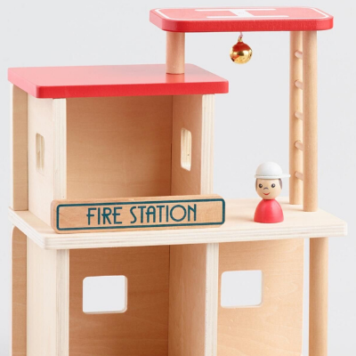 Wooden Fire Station - close up of firefighter and helicopter