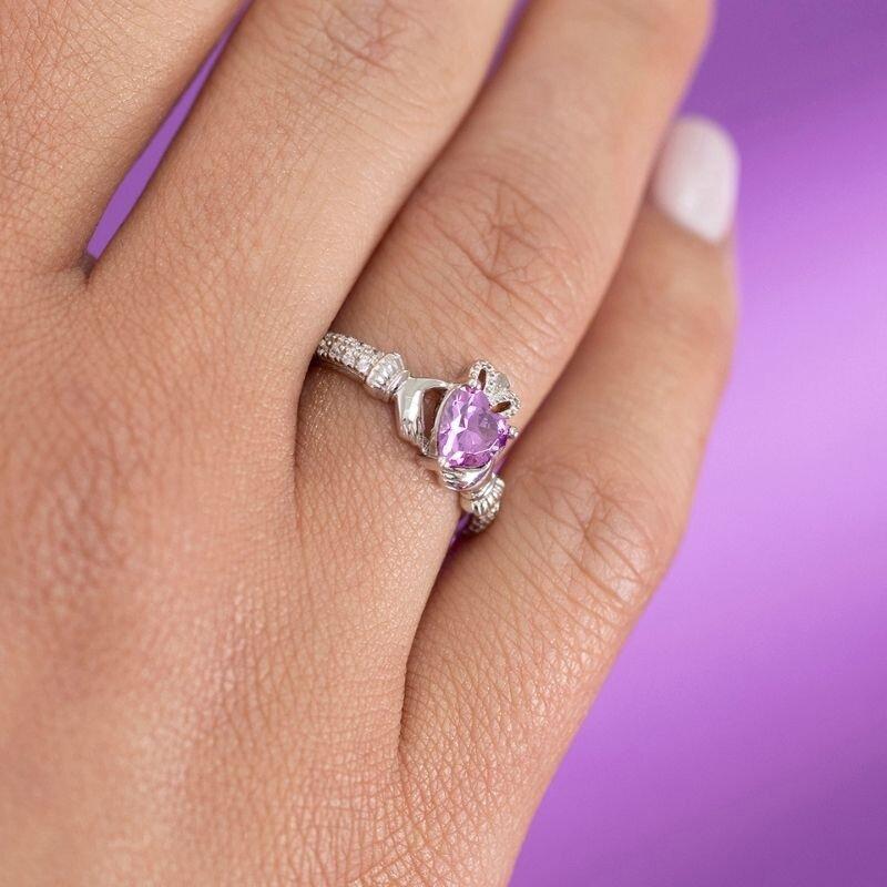 a model wearing Solvar june birthstone amethyst claddagh ring
