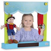 Child playing with wooden table-top carry-case puppet theatre and shop