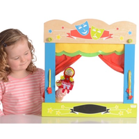 Child playing with wooden finger puppet theatre
