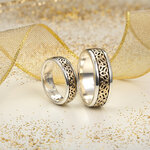 styled image of Solvar gold and silver Trinity Knot ring S21009 and matching gents ring S21010