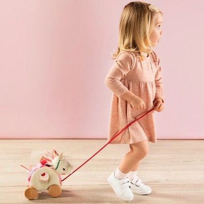 Child playing with pull Along Unicorn