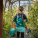 child playing with frog garden kit