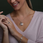 silver four trinity knot pendant s46471 presented on a model