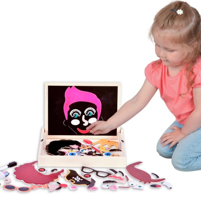 child playing with Magnetic Faces Activity Box