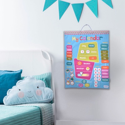 Hand-stitched fabric wall-hanging calendar displayed in kids room