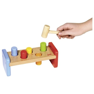 Wooden hammer game for toddlers- pegs being hammered into wooden bench
