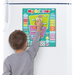 Child using large magnetic wall calendar by Fiesta Craft Toys