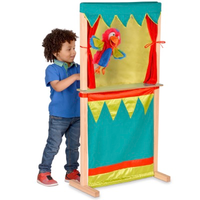 Child playing with wooden puppet theatre and shop - theatre side