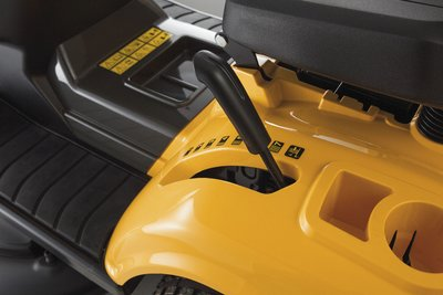The mower features a storage compartment and cup holder.