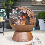 La Hacienda Leaves Globe Firepit with background