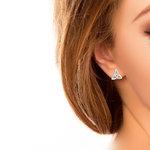 14 karat white gold diamond trinity knot stud earrings  S33102 presented on a model