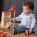 child playing with wooden fire station set