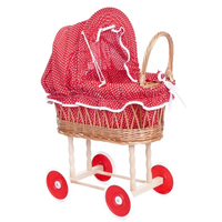 Toy wicker doll's pram with red and white polkadot bedding