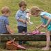 children having a teddy bear picnic w/tea set