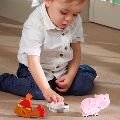 Child playing with Farm Animal Puzzle Set