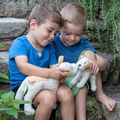 Children playing with small and large Eliot dogs