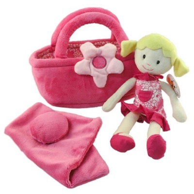 Rag doll Fleur beside her carrycot bed with bedding