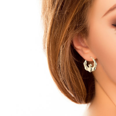 A model wearing Solvar Medium Claddagh Hoop Earrings S3371