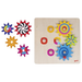 Colourful wooden cog wheel game with the pieces spread out beside it
