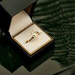 styled image of Solvar gold claddagh ring S2284 in the ring box