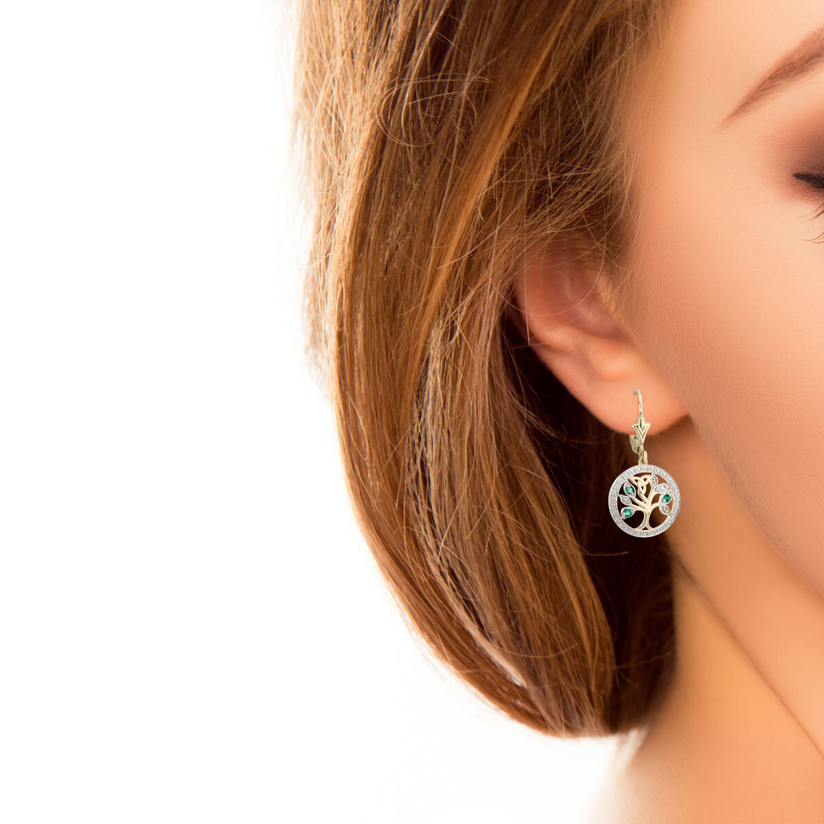 14 karat gold diamond and emerald tree of life earrings S33748 presented on a model