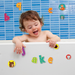 Baby playing with alphabet stickers in the bath