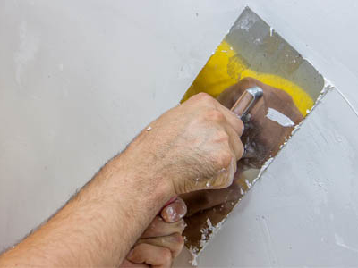 How to Fill Gaps and Holes in Walls with Patching Plaster
