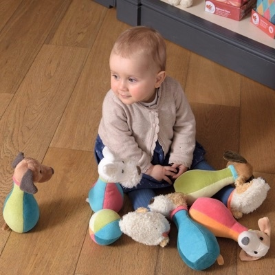 baby playing with dog bowling game